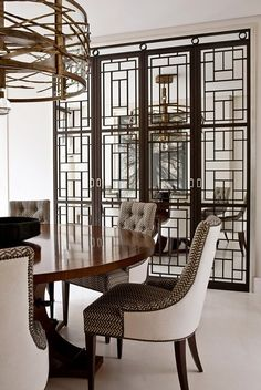 Dining Space - Beautiful round wood table with 2 tone upholstered dining chairs, gold metal chandelier with one imposing open grill room divider. Patio Interior, Home Interior, Interior And Exterior, Interior Decorating, Interior Design, Decorating Ideas, Style At Home, Home Design, Design Moderne