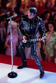 Elvis Presley doll, released in 1998 for $49.98. This was created in honor of the 30th anniversary of Elvis' 1968 TV special. Guitar and sideburns are included, but you'll have to provide your own screaming audience of Barbies. (Photo by: barbiecollector.com)