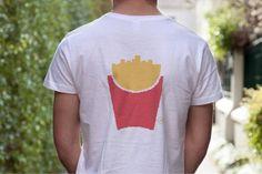 Pommes kann man essen - oder als T-Shirt tragen. McDonald's hat einige seiner ikonischen Produkte zu einer Mode-Kollektion verarbeitet.