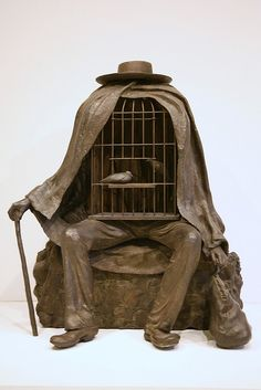 The Healer, 1967, Bronze by René Magritte. <My own (vivi madeleine) ideas: instead, use a coffin to show the death of a person>