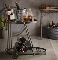 "Victoria Bar Cart      dining     storage  $595.00 Victoria Bar cart      Industrial style bar cart     31"" L x 22"" W x 39"" H     Glass shelves with Iron framework     Minor assembly required     Please allow 2-3 weeks  Freight Fee: $25.00"