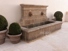 Antique double headed lion wall fountain by Ancient Surfaces.