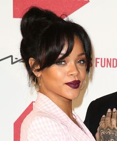 Rihanna Bun And Bangs - http://www.blackhairinformation.com/community/hairstyle-gallery/celebrities/rihanna-bun-bangs/ #rihanna #relaxedhairstyles