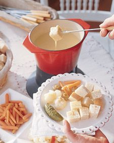 For an hors d'oeuvre, everyone dips into cheese fondue -- a dish with Swiss origins.