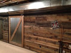 Barn door in the basement to cover furnish and water heater area but with easy access to the storage