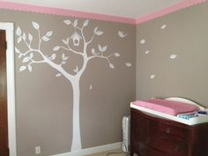 I want to paint this tree in gray and yellow for the crib and dresser in the girls room! I love the idea of the leaves flying in the wind. :)