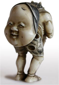 19th Century Japanese Carved Oni with Okame Mask Ivory Netsuke Signed Yasumasa, 19th century