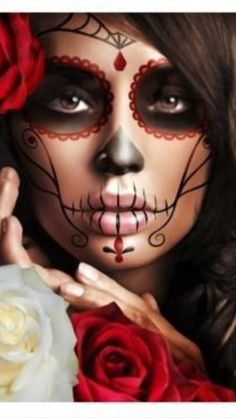 Sugar Skull Make-up. I like this one because you don't have to apply a base of white face paint first. Love it!!