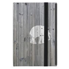 an unique, elegant, hipster and whimsical design of this vector silhouette design of a white sacred elephant on a cool, urban grey vintage wood photo print background, This simple but yet modern design is the perfect gift for fashionista and wild animals lover who loves traditional and rustic deco. This elephant is a sign of good luck!