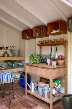 wooden crates along the wall provide shelving and additional storage garden shed interiorsgarden