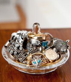 """I try to keep my jewelry as organized as possible but inevitably when I'm rushed pieces get mixed up. Keeping them in categorized bowls and trays at least gives the illusion of a """"controlled mess""""."""