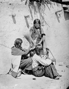 Brushing hair. Hopi. 1879.