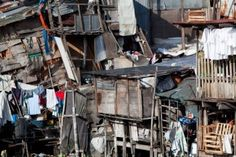 Picture of Shanty town - squatter homes. What appears to be a scene of utter disarray and randomness actually portrays several homes. Photo taken using bubble-level. stock photo, images and stock photography. Gates Of Hell, Walled City, Seaside Towns, We Are The World, Slums, Shadowrun, Environment Design, Urban Decay, Royalty Free Images