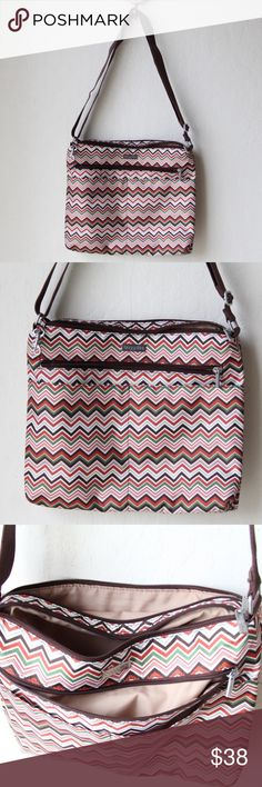"""Baggallini Chevron Cross Body Bag Very functional Bag, Chevron print. 2 free pouches in the front with a zipper pocket behind it. Bag has 2 compartments, one with a zipper pocket and key chain link inside. Other with 2 free pocket and 2 pen slots. L 12"""" x H 10"""" x W .5"""" Baggallini Bags Crossbody Bags"""