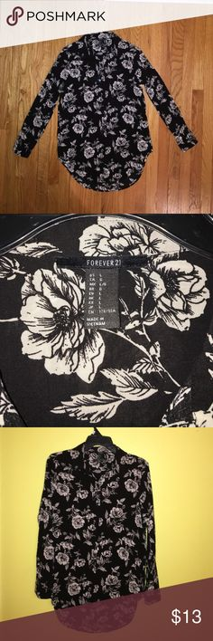 Forever 21 Long Sleeve Top - L Long sleeve button-down from Forever 21. Light, breathable fabric. Design: black with stylish cream colored roses throughout, soft collar, cuffs unbutton. No stains, non-smoking household. Length pairs great over leggings. Make me an offer! Forever 21 Tops Button Down Shirts