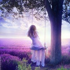 Simple pleasure is swinging and enjoying the beauty of the lilac field.