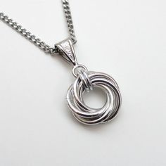 Silver Love Knot chainmail pendant necklace by TattooedAndChained, $25.00....this kind of reminds me of vesper's necklace in casino royale