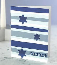 Create a contemporary Hanukkah greeting card with vellum strips and brads. Card stock, punched stars, and few simple crafts supplies complete the project. Jewish Hanukkah, Hanukkah Greeting, Hanukkah Crafts, Jewish Crafts, Hanukkah Decorations, Hanukkah Menorah, Christmas Hanukkah, Hannukah, Happy Hanukkah