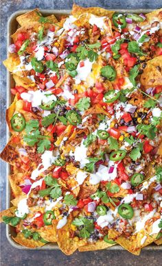 nachos that are guaranteed to be a crowd-pleaser! Simply layer your toppings, bake onto a sheet pan and serve.Loaded nachos that are guaranteed to be a crowd-pleaser! Simply layer your toppings, bake onto a sheet pan and serve. Mexican Food Recipes, Beef Recipes, Cooking Recipes, Drink Recipes, Party Food Recipes, Finger Food Recipes, Party Food Ideas, Recipies, Pan Cooking