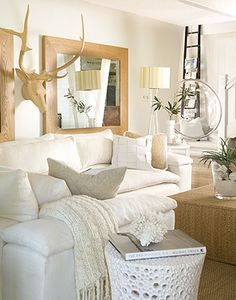 I really like the bubble chair in the background, as well as the white ceramic textured side table in the forefront. The color pallet is the same as my living room, and it makes me rethink a few of my accent ideas...
