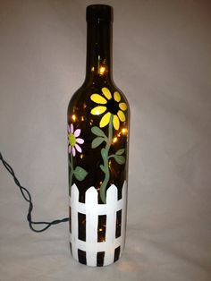 Hand Painted Recycled Wine Bottle with Flowers and a Picket Fence on Etsy, $25.00