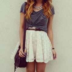 I really like the casual shirt over a lacy dress. Like how the shirt is tied as well. Cute, unique look.