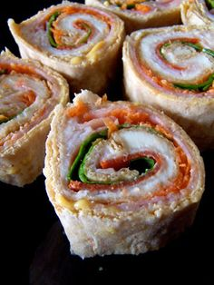 laughing cow cheese, yogurt honey mustard, low sodium ham, low sodium turkey, turkey pepperoni, spinach and shredded carrots flat out bread sushi.