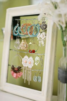 Even if the glass has broken in a picture frame, it can still become an earring holder display. #hand made gifts #do it yourself gifts| http://doityourselfgiftideas.kira.flappyhouse.com