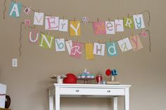 A Very Merry Unbirthday Banner. Alice in by Skrapologie on Etsy, $32.00