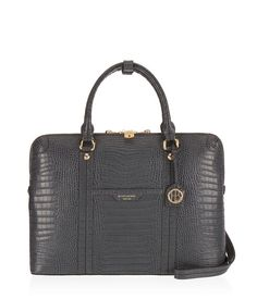 <p>The West 57th Croco Briefcase belongs in every bold, business-minded Bendel Girl's luxury handbag collection. Designed with the modern professional woman in mind, this piece boasts exotic crocodile embossed leather, custom Henri Bendel details, and a dedicated laptop compartment. This chic designer handbag is not your mother's briefcase.</p>