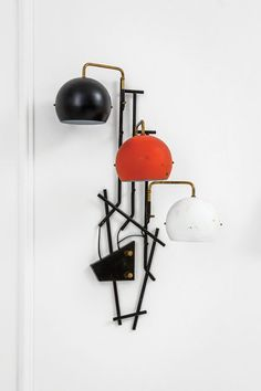 Anonymous; Enameled Metal and Brass Wall Light by Stilnovo, 1950s.