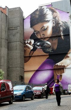 By Smug, Glasgow .... Apparently this fellow takes photos of street art. So the art here is the photo, not the girl with the magnifying glass.