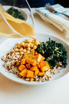 AMAZING Brown Rice Bowl with kale, sweet potatoes, chickpeas and a creamy peanut sauce. Vegan, gluten-free, 18 grams of protein and 20 grams of fiber!