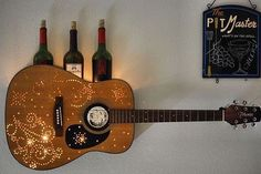 Via @talented_musicians_ Guitar Wine Rack-- made this out of an old, broken guitar