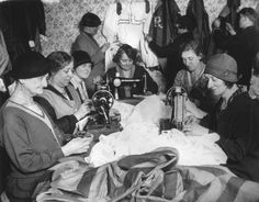 A group of volunteers making costumes from three miles of material for the 2500 performers taking part in the Greenwich Night Pageant held in the...