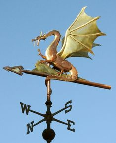 The Web Winged Dragon Weathervane is one of our favorite designs. In fact, we have a medium sized Web Winged Dragon weathervane in our personal collection and often proudly display it in our living room. Wind Dancer, Man Cave Art, Weather Vanes, Green Dragon, The Hobbit, Wales, Vikings, Dragons, Copper