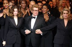 Defile Yves Saint Laurent avec Catherine Deneuve et Laetitia Casta - 2002 http://www.vogue.fr/thevoguelist/yves-saint-laurent/223