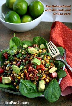 Red quinoa salad featuring avocado, grilled corn, tomatoes and cilantro with an out-of-this-world cumin and lime dressing.