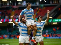 Argentina s Nicolas Sanchez is lifted in the air by team-mates Lucas  Noguera (left 18cbad8aeca70