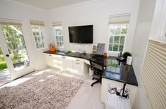 Love the dark counter top against the white wall! And orange accents!!