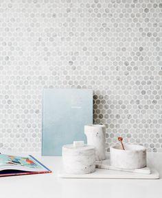 Kitchen: marble penny-round mosaic tile splashback, small marble circular round storage boxes