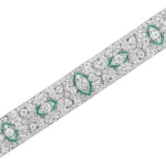 Art Deco Platinum, Diamond and Emerald Bracelet  The wide pierced strap of geometric design spaced by five navette-shaped panels outlined in French-cut emeralds, centering one old European-cut diamond approximately 1.85 cts. and 4 old European-cut diamonds, set throughout with 300 old European-cut diamonds, altogether approximately 32.00 cts., circa 1925, approximately 52 dwt. Length 7 1/2 inches.