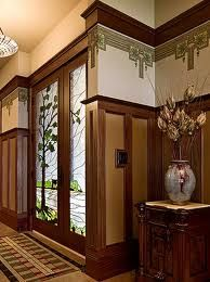 """Hard to believe this is a new house!  """"In a new house in Iowa, the foyer is all Arts & Crafts with paneled wainscot and a period pendant frieze from Bradbury & Bradbury bradbury.com."""""""