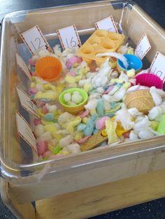Ice cream sensory tray - number cards, cotton wool balls and scoops
