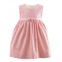 8ab4c205a4267 An adorable baby pink velvet pinafore dress with a pretty grosgrain ribbon  and bow at the