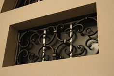 Decorative Faux Wrought Iron window insert by BMD Woodworks