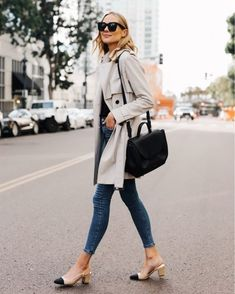 b2b423bc5e Blonde Woman Wearing Trench Coat Denim Skinny Jeans Chanel Slingbacks  Polene Number One Handbag Monochrome Black