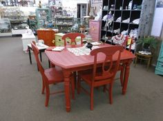 SOLD - Shabby chic table and 4 chairs - painted red, distressed and finished in a tinted wax. ***** In Booth A8 at Main Street Antique Mall 7260 E Main St (east of Power RD on MAIN STREET) Mesa Az 85207 **** Open 7 days a week 10:00AM-5:30PM **** Call for more information 480 924 1122 **** We Accept cash, debit, VISA, Mastercard, Discover or American Express