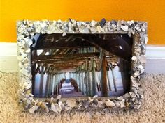 DIY sand and shell picture frame. Glue, sand, shells, and a picture frame. Enjoy :)