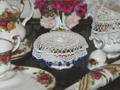 An old-fashioned idea that's still useful--crocheted doilies with bead weights--ideal food covers to keep flying and crawling pests from invading on picnics or patio parties.  Free pattern here.